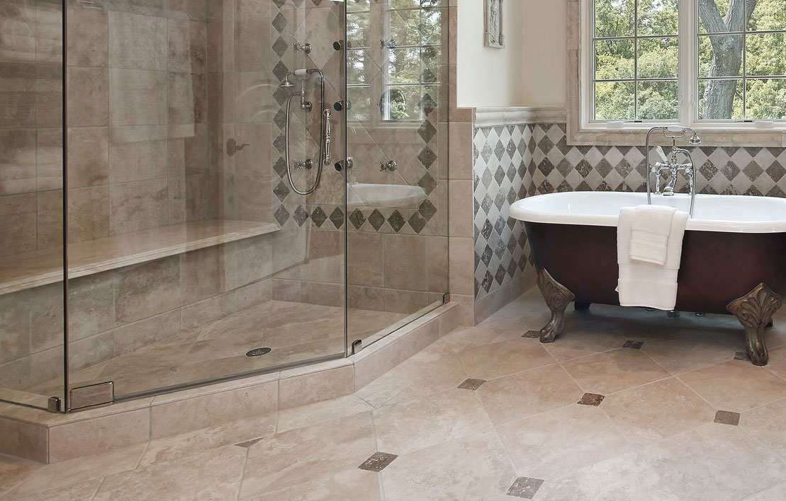 Bathroom remodel with tiled floors and walls, free standing tub and vanity cabinets.